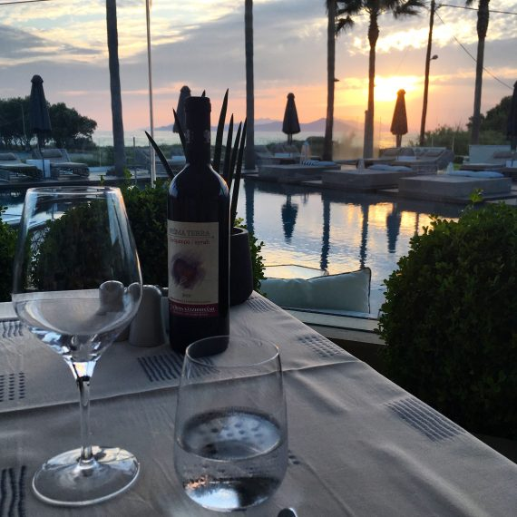 Enjoy the food, wine, and cocktails at the pool side bar Sips & Bites